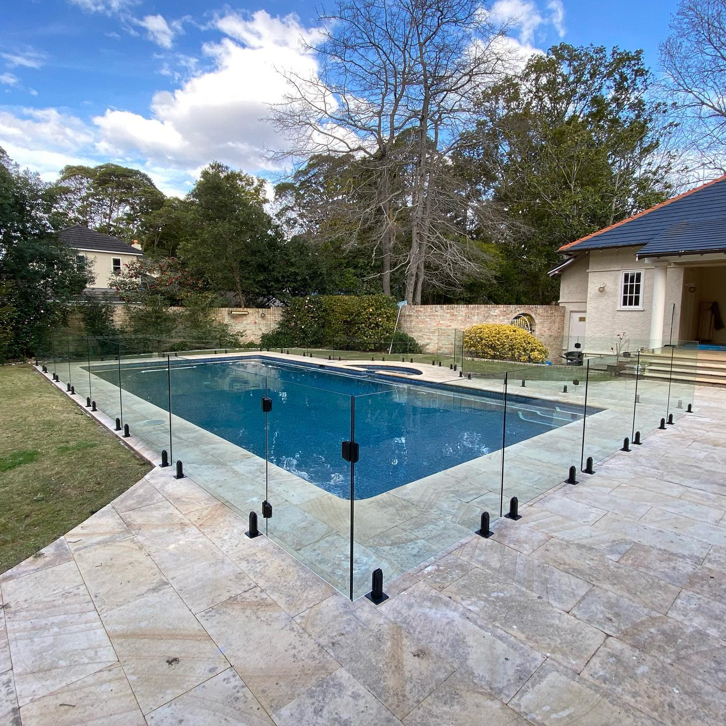 Frameless Glass Pool Fencing with Polaris soft close hinges and Polaris latch in a matte black finish - Wharoonga NSW